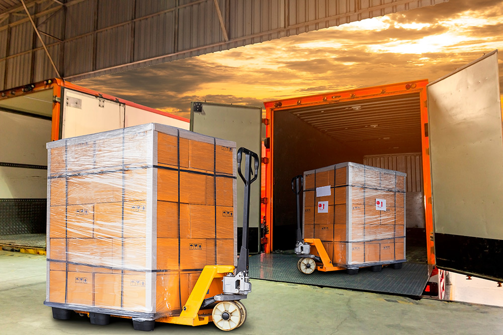Warehouse dock load pallet goods into shipping container truck